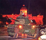 A tank is stationed at the Royal Plaza in front of the Ananta Samakhom Throne Hall