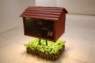 Ehsan Ul Haq, <i>Cityscape</i>, 2009, electrical system including a 24v D.C. motor, infrared sensor, DVD player and LCD, image courtesy of the artist.