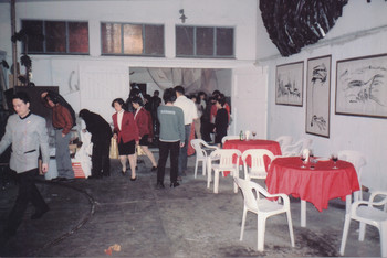 Attendees at an Artist Commune Exhibition