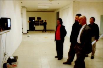 Ding Yi, Ai Weiwei, and Uli Sigg at 'Fuck Off'