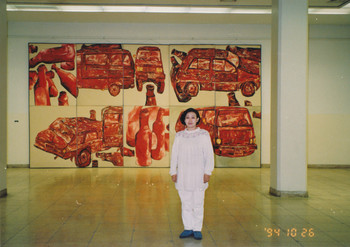 Photograph of Yang Keqin in Front of Her Work