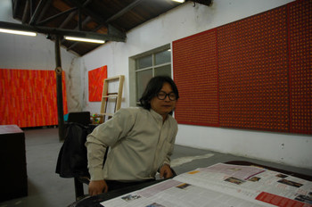 Ding Yi in his studio