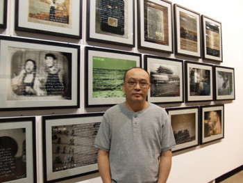Zhang Xiaogang in front of his work
