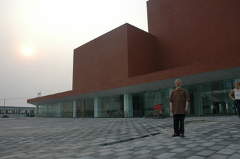 Li Xianting stands outside the museum
