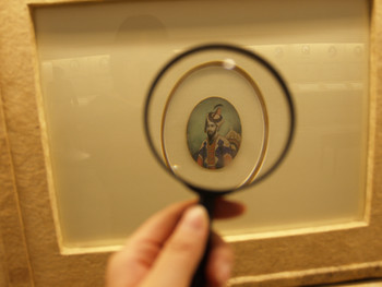 Looking at a miniature painting at the Lahore Museum