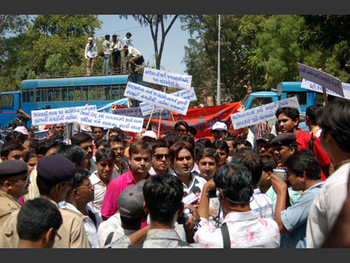 Outside the gates, a VHP mob begins to form and gradually expands in number.