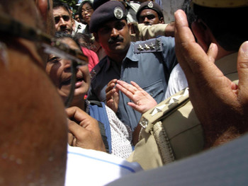 A busload of protestors from Mumbai are denied entry.