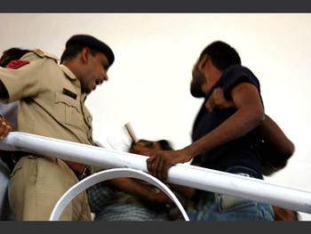Around mid afternoon Chandramohan is dragged out of his studio by the police and VHP.