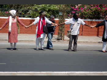 Not allowed access to their Alma Mater; artists form a human chain on the street.