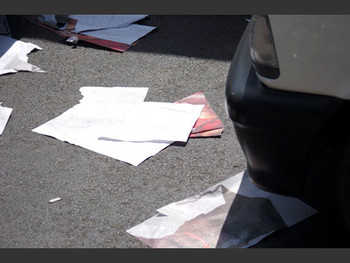 Posters lie abandoned after the police arrest 10 students and disperse the peaceful demonstrators.