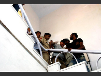 Chandramohan dragged out of his studio by the police and VHP.