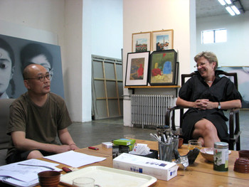 Zhang Xiaogang and Jane Debevoise in Zhang Xiaogang's studio.