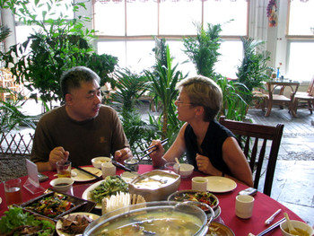 AAA team at lunch with Song Yongping and Song Yonghong. Song Yongping chatting with Jane Debevoise.
