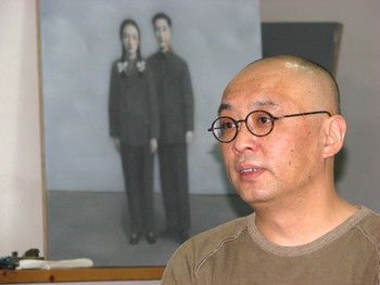 Zhang Xiaogang in his studio with new work.