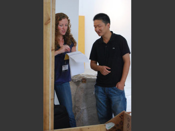 Megan Connolly, AAA Researcher for China, and artist Ou Yangchun.
