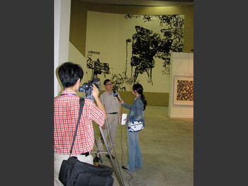 Pan Gongkai discussing his work during an interview.