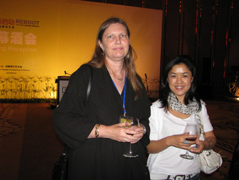 (L-R) Britta Erickson with exhibiting artist Cui Xiuwen.