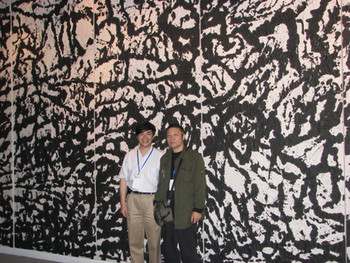 Shen Kuiyi with exhibiting artist, Li Huasheng in front of Li's work: