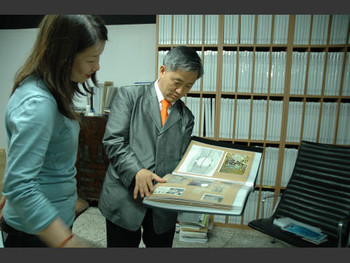 Kim Daljin shows material he has been collecting since being a teenager.