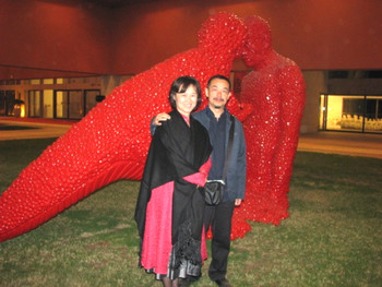 Sui Jianguo and wife Li Aidong with sculpture, Dialogue.