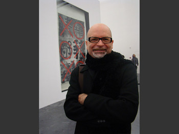 UCCA: Red Gate Gallery Director Brian Wallace with ink painting by Gu Wenda in the background.