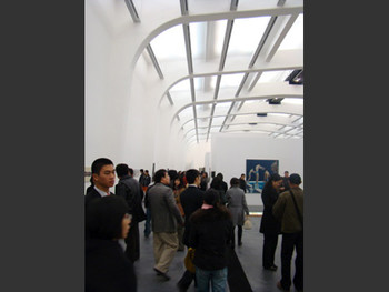 UCCA exhibition hall. Oil painting by Zhang Peili in the background.
