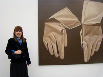 UCCA: Asian Art Coordinating Council Curator Julie Seagraves with oil painting by Zhang Peili.