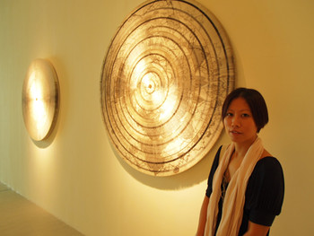 Artist Mia Wen Hsuan Liu in front of her work Peach Punch!, 2009, blank tickets from the Guggenheim museum, New York, plywood, 117x117x6cm
