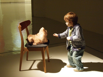 Patricia Piccinini, Doubting Thomas, 2008, silicone, fiberglass, human hair, clothing, chair, 100x53x90cm