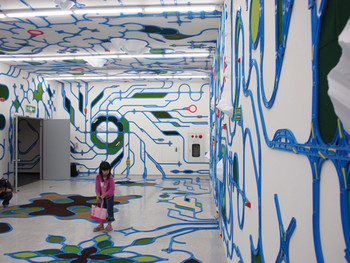 A viewer walking through Paramodel's installation, Paramodelic- graffiti , 2009, mixed media, dimensions variable