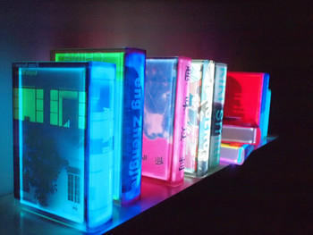 Partial view of Airan Kang's The Space of book – The Sublime, 2009, mirror, two projectors, plastic books and sensors