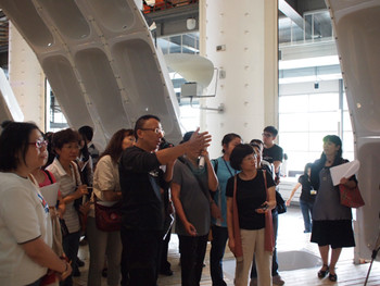 Lu Li H., director of Interbreeding Field, giving a guided tour