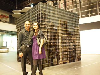 Rashid and Aroosa Naz Rana in front of his work Desperately Seeking Paradise, 2007-2008, C-print, diasec., stainless steel, 300x300x300cm