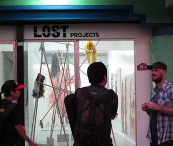 David Griggs (right) welcomes artists during the opening of Pow Martinez's exhibition, 'March of the Pigs', Lost Projects, October 6, 2010.