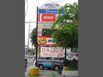 Handpainted sign of DAGC along Pasong Tamo Ext., February 2011.