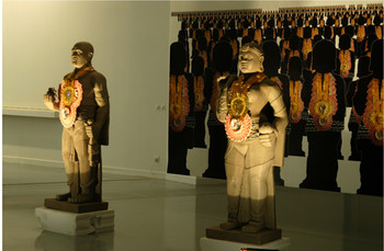 Raqs Media Collective, The Reserve Army, 2008, fibreglass, sand, barbed wire, ornaments, and vinyl s
