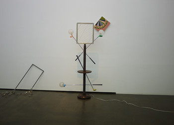Left, Key Ring, 2012, metal, 90 x 40 x 70 cm; right, Golf Bat Sculpture, 2012, metal, light, wood, 130 x 130 x 190