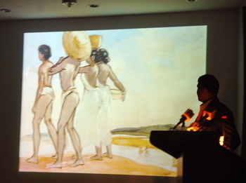Zia-ul-Karim showing an image of Zain-ul-Abedin's work during his talk.