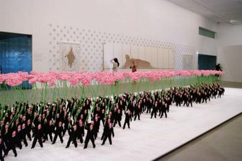 (Front) Zhu Weibing and Ji Wenyu, People holding flowers, 2007, synthetic polymer paint on resin, velour, steel wire, dacron, lodestone and cotton, 400 pieces