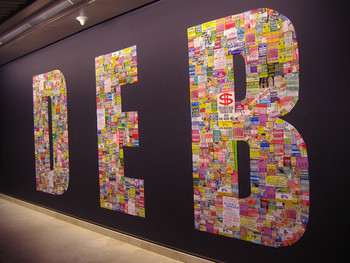 Image: Roslisham Ismail, <i>DEB (Dasar Ekonomi Baru)</i>, 2008, stickers collaged on wall.