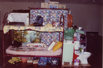 Image: Roslisham Ismail, <i>The Story Behind Social Ill</i>, 2000, household items.
