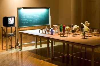 Kim Beom, Objects Being Taught They Are Nothing But Tools, 2010, daily objects, wooden chairs, wooden tables, blackboard with<br/> fluorescent light, courtesy of the artist