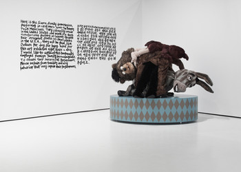Gim Hong Sok, The Bremen Town Musicians, 2006-2007, wall text (ink), cartoon characters made of foam rubber, fabric, steel,<br/> courtesy of the artist
