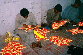 Making reflective sticker designs, Karachi. Image: courtesy Durriya Kazi