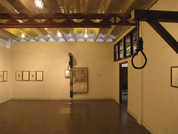 Installation view, Atul Dodiya, Left: Breakfast Project/Piero Pierced, 15 newspaper cuttings and 15 pierced reproductions, each<br/> framed with mount and glass, 58 x 41 cm each, 2008. Right: The Names of Statues, oxidised mild steel, mirror, fiberglass, watercolour<br/> and charcoal on paper, gallow size 259 x 107 cm, painting size 152 x 92 cm, 2010