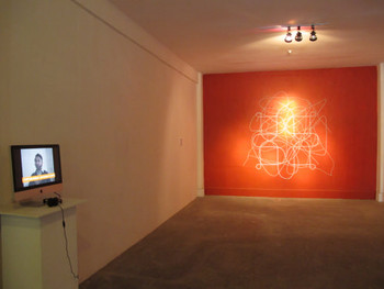 Installation view, Anita Dube, Front: Kissa-e-Noor Mohammed (Garam Hawa), 2004, video, 15 min; Back: Neti Neti (not this, not this<br/> either), 2011, enamel eyes on wall