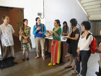 Co-curator Alia Swastika (centre) introducing the exhibition to visitors