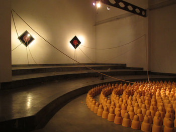 Installation view, Albert Yonathan, Cosmic Labyrinth: The Bells, 2011, terracotta (low fired ceramics), wooden beads, audio and video<br/> channel, dimensions variable, installation and performance