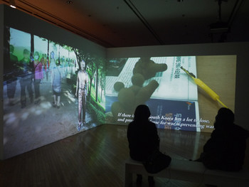Suyeon Yun and Jinyoung Koh, Temporary Square, 2011, HD video and still image projection, color, sound, 10 min