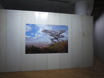 Ash Keating, Zi Namsan Plus, 2011, site-specific installations of vinyl sticker of digital artwork on a replica construction installed<br/> within Artsonje Center and a mirroring public outcome on an existing construction site's wall behind Artsonje Center, dimensions<br/> variable